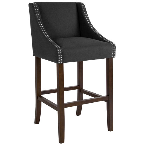"""Our Carmel Series 30"""" High Transitional Walnut Barstool with Accent Nail Trim in Charcoal Fabric is on sale now."""