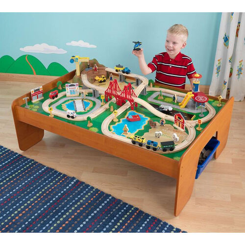 Our Kids Wooden Ride Around Town Train Set and Table with Two Storage Tubs Includes 100 Pieces is on sale now.