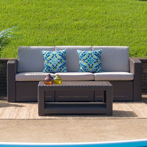 Our Chocolate Brown Faux Rattan Sofa with All-Weather Beige Cushions is on sale now.