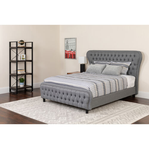 Our Cartelana Tufted Upholstered Full Size Platform Bed with Silver Accent Nail Trim in Light Gray Fabric is on sale now.