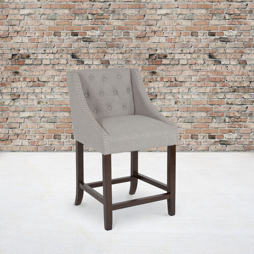 """Our Carmel Series 24"""" High Transitional Tufted Walnut Counter Height Stool with Accent Nail Trim in Light Gray Fabric is on sale now."""