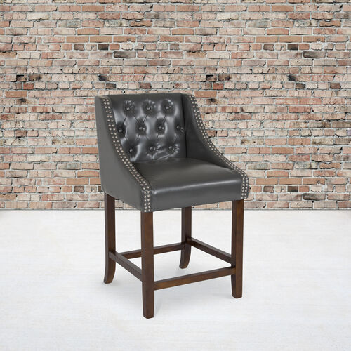"""Our Carmel Series 24"""" High Transitional Tufted Walnut Counter Height Stool with Accent Nail Trim in Dark Gray LeatherSoft is on sale now."""