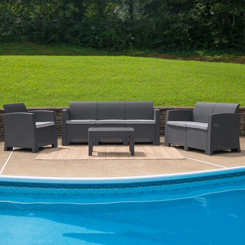 Our 4 Piece Outdoor Faux Rattan Chair, Loveseat, Sofa and Table Set in Dark Gray is on sale now.