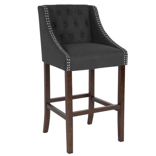 "Our Carmel Series 30"" High Transitional Tufted Walnut Barstool with Accent Nail Trim in Charcoal Fabric is on sale now."