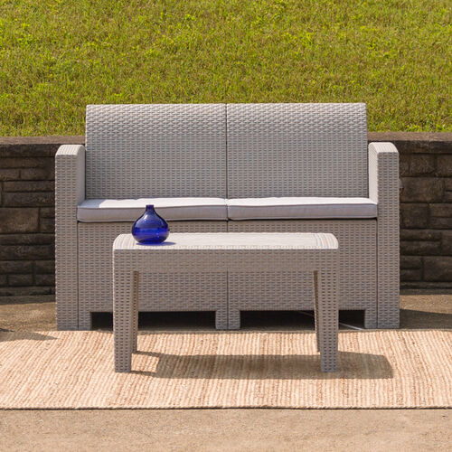 Our Light Gray Faux Rattan Loveseat with All-Weather Light Gray Cushions is on sale now.