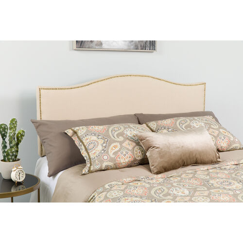 Our Lexington Upholstered Full Size Headboard with Accent Nail Trim in Beige Fabric is on sale now.