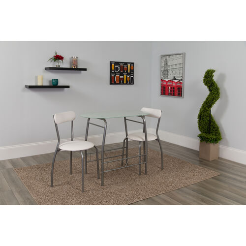 Our Sutton 3 Piece Space-Saver Bistro Set with White Glass Top Table and White Vinyl Padded Chairs is on sale now.
