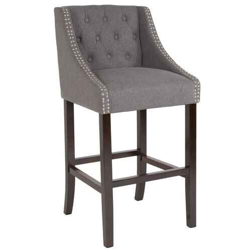 "Our Carmel Series 30"" High Transitional Tufted Walnut Barstool with Accent Nail Trim in Dark Gray Fabric is on sale now."