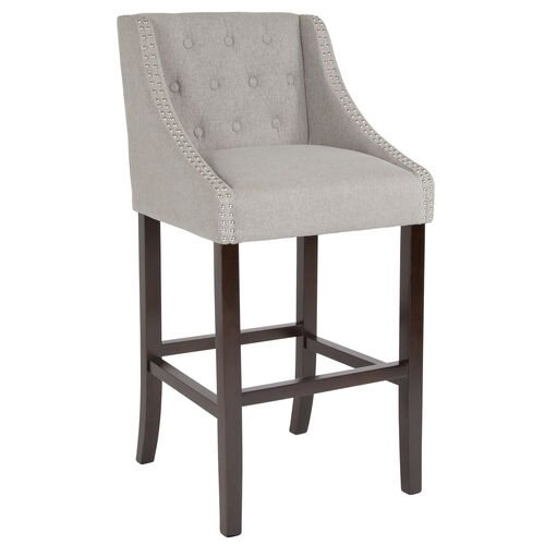 """Our Carmel Series 30"""" High Transitional Tufted Walnut Barstool with Accent Nail Trim in Light Gray Fabric is on sale now."""