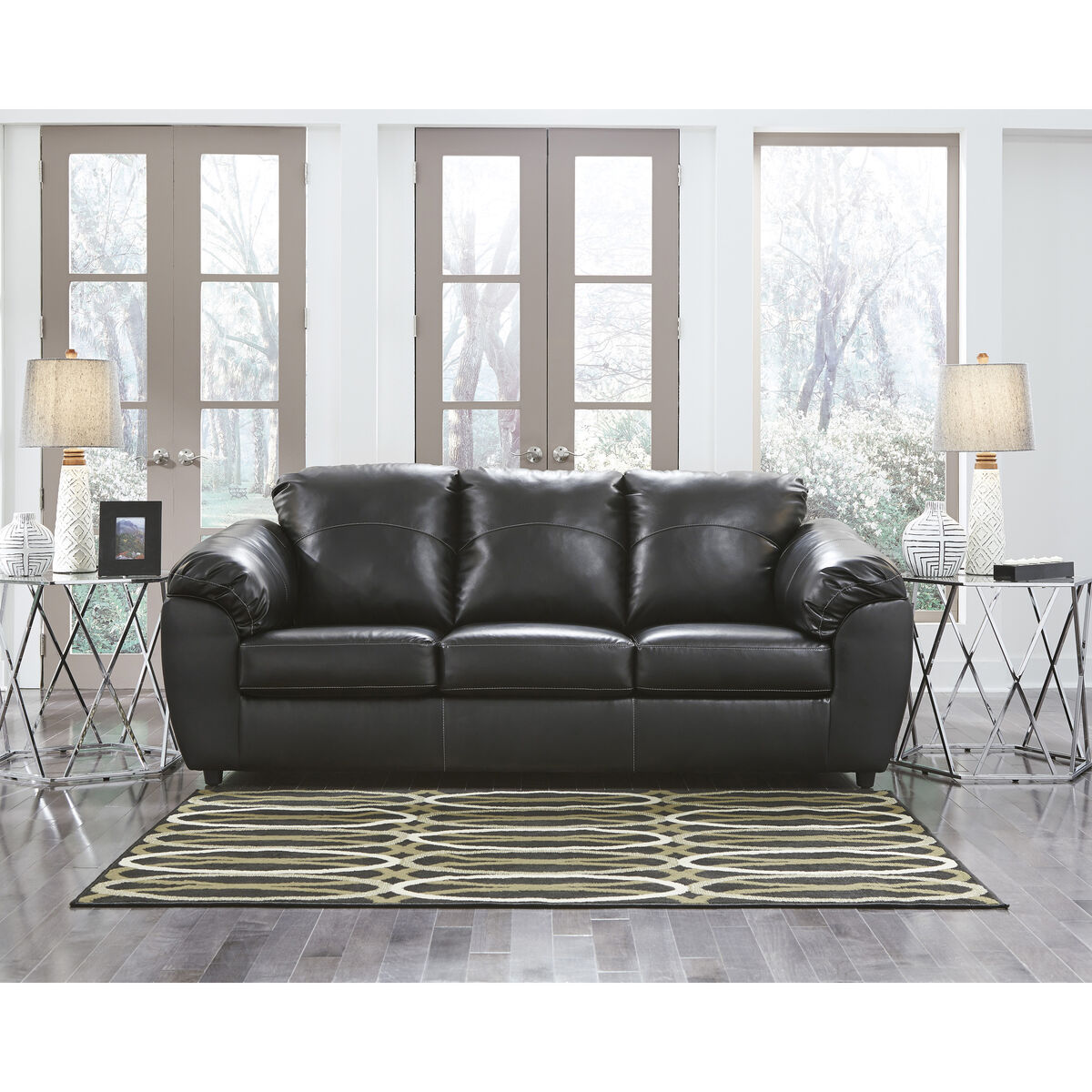 Our Benchcraft Fezzman Sofa In Black Leather Is On Now