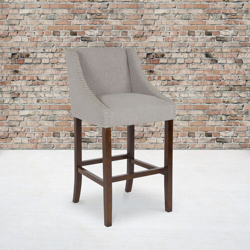 """Carmel Series 30"""" High Transitional Walnut Barstool with Accent Nail Trim in Light Gray Fabric"""